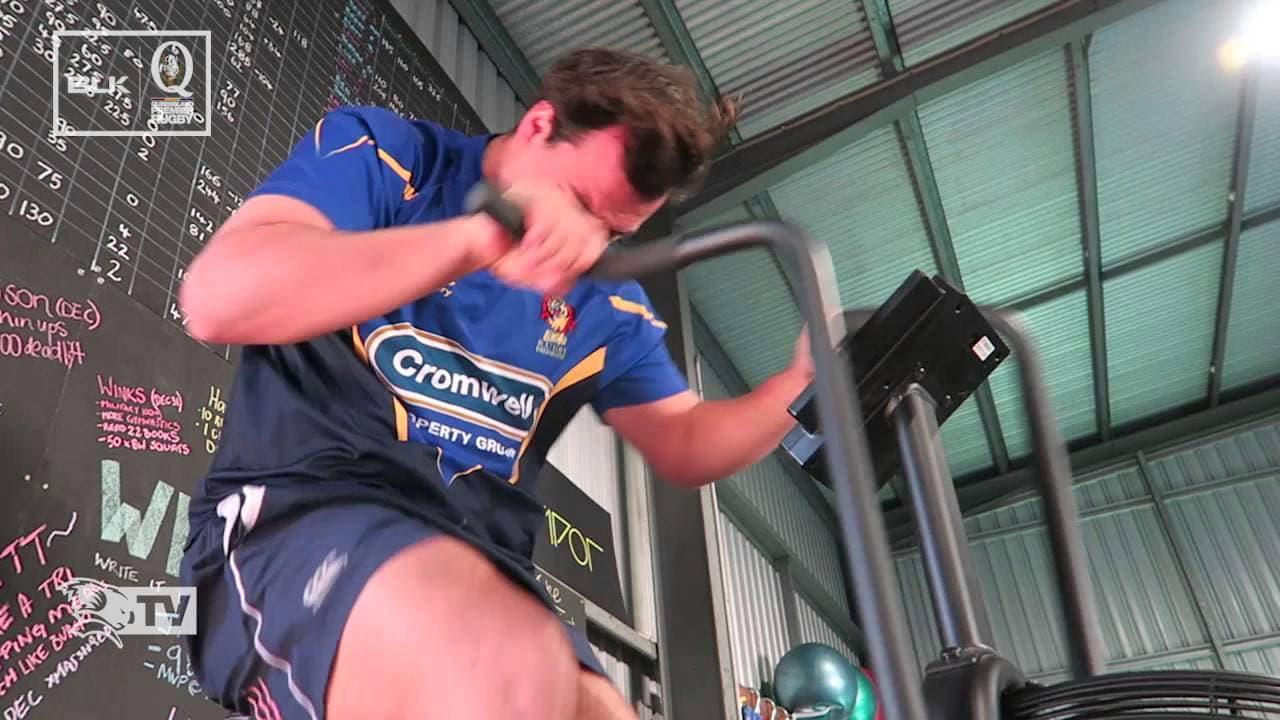 rugby player riding assault bike cartoon